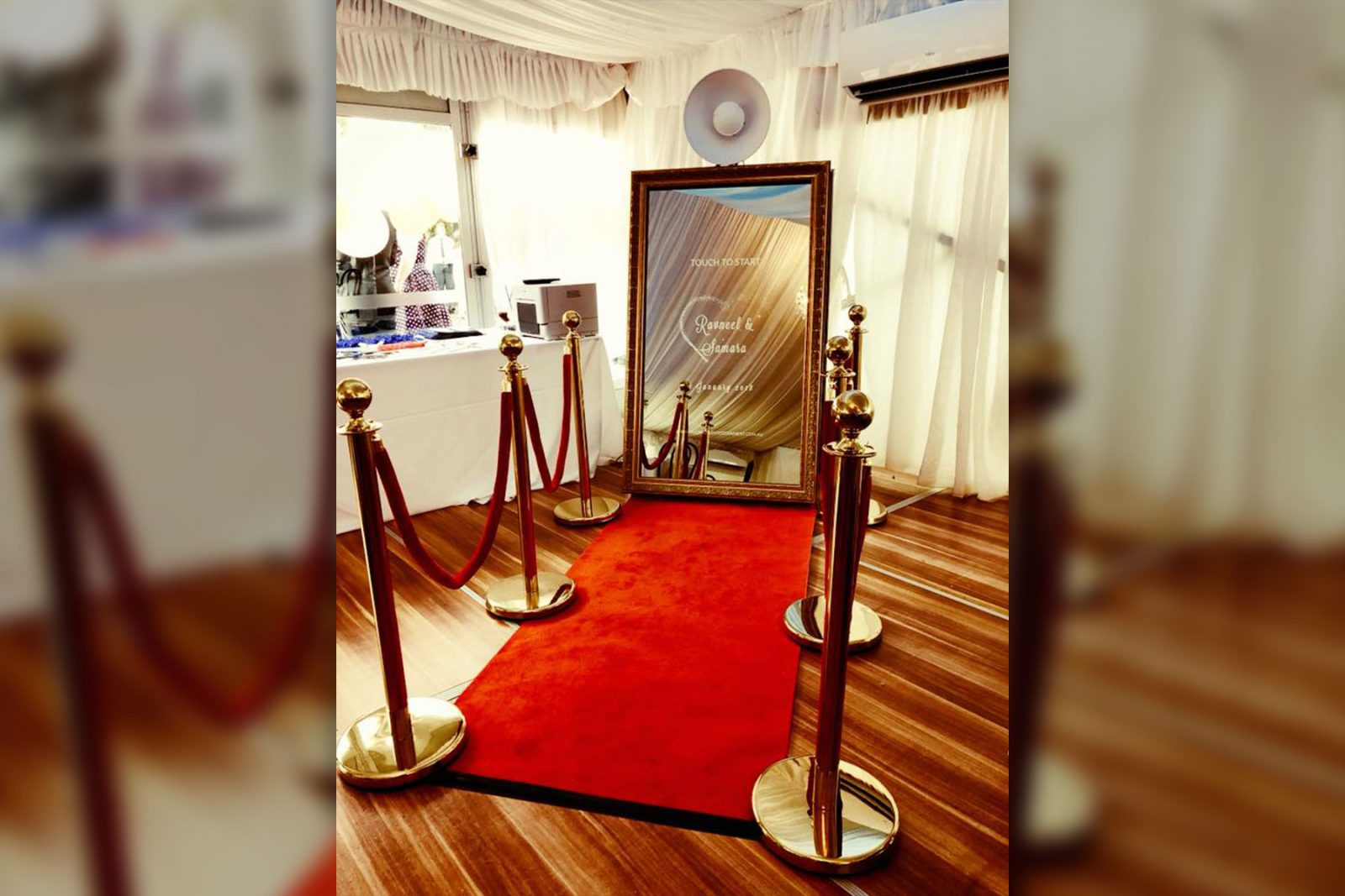 mirror me photo booth with red carpet